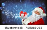 santa claus with a gift box and ... | Shutterstock . vector #765089083