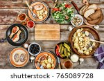 dining table with a variety of... | Shutterstock . vector #765089728