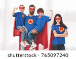 a young family in red and blue... | Shutterstock . vector #765097240
