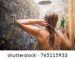 woman washing hair in shower...   Shutterstock . vector #765115933