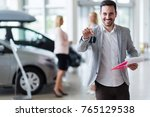 handsome salesman at car... | Shutterstock . vector #765129538