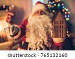 happy santa claus in eyeglasses ... | Shutterstock . vector #765132160