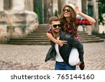 couple in love. man carrying... | Shutterstock . vector #765144160