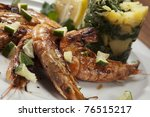 king prawns with potato and... | Shutterstock . vector #76515217