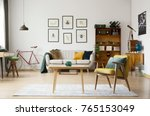 blue pillow on yellow armchair... | Shutterstock . vector #765153049
