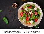 dietary salad with tomatoes ... | Shutterstock . vector #765155890