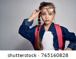 the schoolgirl raised her... | Shutterstock . vector #765160828