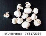mushroom champignon on dark  ...   Shutterstock . vector #765172399