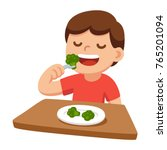 cute cartoon happy boy eating... | Shutterstock .eps vector #765201094