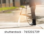 worker cleaning driveway with...   Shutterstock . vector #765201739