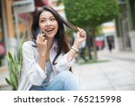 asia woman walking and using a... | Shutterstock . vector #765215998