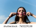 girl posing with pink lips and...   Shutterstock . vector #765229138