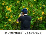 an asian young man looking at... | Shutterstock . vector #765247876