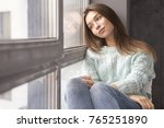 cute adult young woman sitting... | Shutterstock . vector #765251890