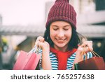 happy young woman traveler... | Shutterstock . vector #765257638