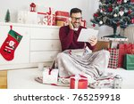 smiling young man listening... | Shutterstock . vector #765259918