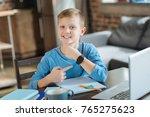 modern gadget. delighted... | Shutterstock . vector #765275623