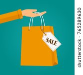 hand holding a bag shopping...   Shutterstock .eps vector #765289630