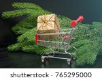 shopping cart with gift box and ... | Shutterstock . vector #765295000