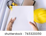 hand of woman holding papers on ...   Shutterstock . vector #765320350