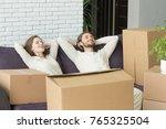 happy couple relaxing on sofa... | Shutterstock . vector #765325504