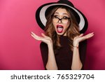 image of young shocked lady... | Shutterstock . vector #765329704