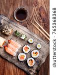 sushi set on pottery plate with ...   Shutterstock . vector #765368368