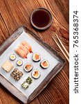 sushi set on pottery plate with ...   Shutterstock . vector #765368374