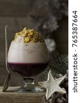 Small photo of Christmas Breakfast - grape jelly on agar agar with yogurt and muesli in cognac glass