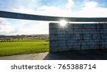 Small photo of Bannockburn, Stirlingshire, Scotland, UK; November 26th 2017: Site of the Battle of Bannockburn in 1314. Sun flare under the words carved on the wooden ring of the rotunda.