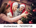 happy young family decorating... | Shutterstock . vector #765390718