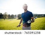 golf player hitting shot with...   Shutterstock . vector #765391258