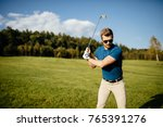 golf player hitting shot with... | Shutterstock . vector #765391276