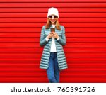 fashion smiling woman is using... | Shutterstock . vector #765391726