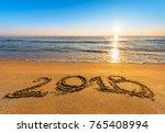 number 2018 written on seashore ...   Shutterstock . vector #765408994