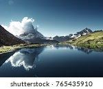 reflection of matterhorn in... | Shutterstock . vector #765435910