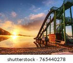sunset shore and toboggan...   Shutterstock . vector #765440278