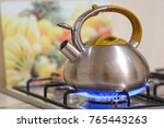 kettle on a stove | Shutterstock . vector #765443263