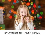 girl holding  playing  eating a ...   Shutterstock . vector #765445423