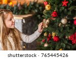 girl holding  playing  eating a ...   Shutterstock . vector #765445426