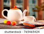 tea set and scarf on the... | Shutterstock . vector #765465424