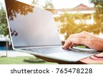 students young man using laptop ... | Shutterstock . vector #765478228