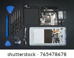 the disassembled cell phone... | Shutterstock . vector #765478678