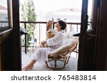 relaxed young woman in white... | Shutterstock . vector #765483814