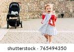 Happy Toddler Girl Walking Wit...