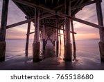 a warm autumn sun sets over a... | Shutterstock . vector #765518680