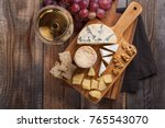Tasting Cheese Dish On A Woode...