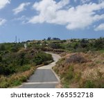 winding narrow road bordered by ...   Shutterstock . vector #765552718