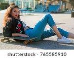 summer portrait of young woman... | Shutterstock . vector #765585910