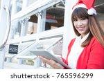 Asian Woman Wear Santa Hat...